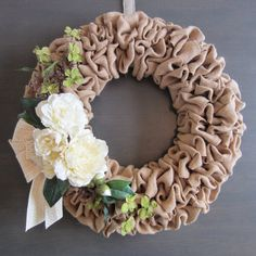 Elegant burlap wreath with cream roses and peony and green blossoms.  Would be a lovely addition to wedding decor.