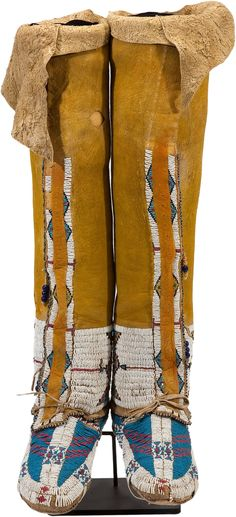 A PAIR OF CHEYENNE BEADED HIDE BOOT MOCCASINS . c. 1890... | Lot #50014 | Heritage Auctions