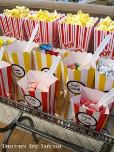 This is so cute!  Add your own choice of candies to your popcorn to make it taste the way you want.  Great party idea.