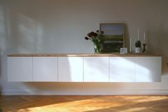 IKEA Besta Storage | By adding a single wooden top to this collection of cabinets it ...
