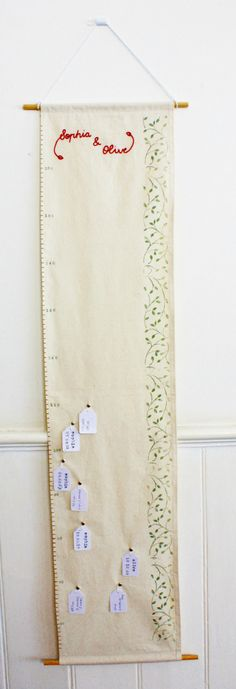 Muslin height chart. Fabric, fabric pen and embroidery. Way to personalize.