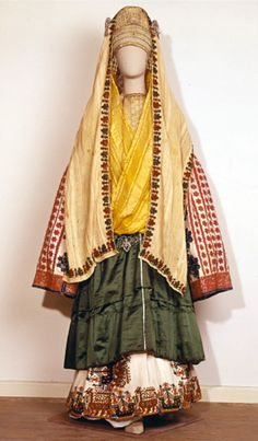 Bridal costume of Astypalaia Bridal costume of Astypalaia  (18th–19th century)  This impressive bridal costume from the Aegean island of Astypalaia has a blend of Byzantine and Renaissance influences. The headdress includes long silk veils and a velvet cap encrusted with pearls and embroidered with gold wire.