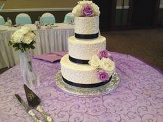 Ornate three tier cake with stunning flowers and crystals