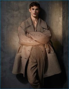 Mixing plaid prints, Kit Butler wears a check Raf Simons wool coat with a Kenzo jumpsuit. Kit Butler, Blake Steven, The Fashionisto, Raf Simons, Men Street, Wool Coat, Editorial Fashion, Fitness Models, Menswear