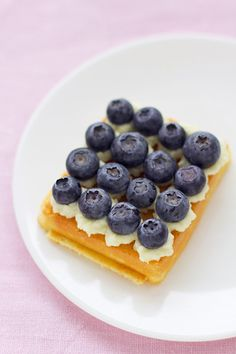 Waffle with whipped cream and blueberries.