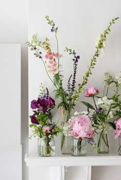 Decorate shelves and fireplaces with mix matched vases
