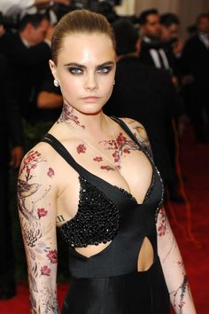 Cara Delevingne and her fake tattoos at the 2015 Met Gala. Rock on, gurl.