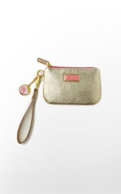 Add some shimmer to your night! This gold lizard-embossed little wristlet can keep all your essentials--cards, cash, and a lipgloss--organized and handy for a fun night out.