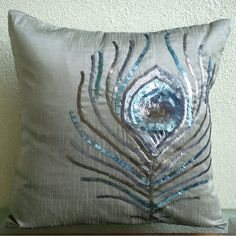Peacock Feather- 14x14 Inches Throw Pillow Covers - Silk Pillow Cover with Sequin Embroidery The HomeCentric,http://www.amazon.com/dp/B004NPRU4C/ref=cm_sw_r_pi_dp_xvDzsb0CADN953KW