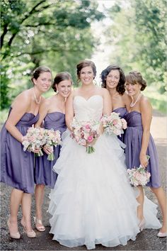 Love this wedding gown and the purple bridesmaid dresses