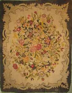 Waldoboro type Raised Floral Bouquet Hooked Rug.