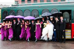 an unexpected wedding picture prop for the rainy wedding day- love the ladies all in rain boots with the umbrellas. so cute! @Laura