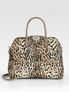 Valentino.  When I am an old lady, instead of purple hats I am going to wear leopard all the time.