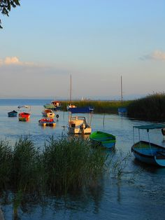 Small boats on the shores of Ohrid Lake in Macedonia (by STEHOUWER AND RECIO).