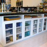 Remember when every home we saw on HGTV was being renovated with a breakfast bar? They have their place for sure, but they don't really lend much in the way of design as far as storage or even looks go. Many homes, rentals, and apartments have them, but did you know that overhang of countertop can be doing more for you? Want to see what this space looks like now? Should I keep asking silly questions?