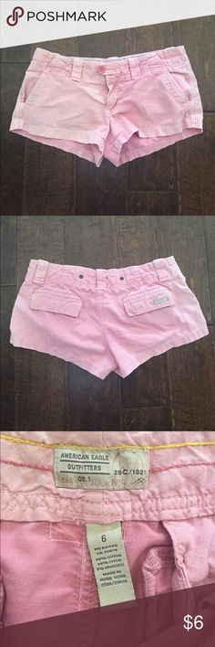 American Eagle Faded Pink Shorts These are khaki material, distressed pink. They are missing a button on the inside but I still wore like that because there is another button on the outside. Preloved. American Eagle Outfitters Shorts