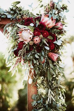 Pink and marsala by Lauren Scotti Photographer // Florals by The Bloomin Gypsy // King Protea // Dahlia // Eucalyptus Garland