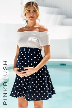A polka dot print maternity skater skirt with an elastic waistband. Material has high stretch. This style was created to be worn before, during, and after pregnancy.