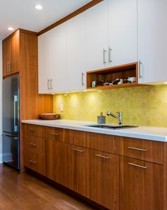 Love the combination of white lacquer and natural cherry cabinetry in this contemporary kitchen.