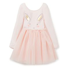Top: Cotton/Elastane blend. Skirt: 100% Nylon. Long sleeve tutu dress features front placement bunny face motif print with attached pom pom tail. Regular fitting silhouette with full layered skirt. Avaialble in Soda Pink.