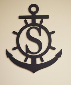 """Anchor Initial Wood Monogram This Anchor Initial Wood Monogram is a great addition to your home decor. Perfect for the lake home, cabin or your beach home, you just need to add your own touch of paint to make this a unique piece of wall art. This also makes a thoughtful gift to send to family and friends. Please Note: This wood sign comes unfinished. DETAILS: 18"""" H 1/2"""" Birch Wood Arrives Unfinished & Ready to Paint For Indoor or Outdoor Use Single Initial Only *Please allow 2-3 days for…"""