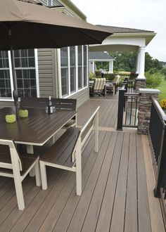 This custom deck and porch space was built using TimberTech mocha decking with double pecan picture from border. The porch section of this space is perfect for