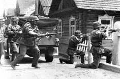 Waffen-SS  048.( original caption). Waffen SS unit opening fire.Date and location unknown.