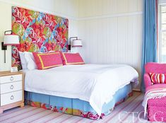In the guest bedroom, the bedskirt is a blue linen from Threadcount; while the headboard and bedskirt trim are through Clarence House. Pink shams and chaise fabric are Manuel Canovas.
