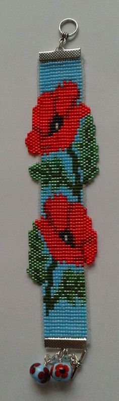 A loomed poppy bracelet by Bella Gray - inspired by Erin Simonetti's Prosperity Dragon Cuff and created following the project in Issue 36 of Bead.