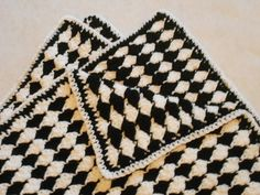 Ravelry: Almost Reversible Baby Blanket or Afghan pattern by Marie Anne St. Jean