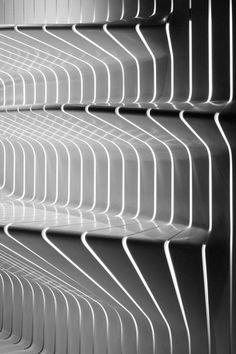 http://www.dezeen.com/2009/11/11/corian-super-surfaces-showroom-by-amanda-levete-architects/