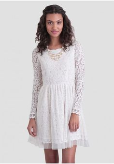<p>Accented with a scalloped hem and neckline, this white floral lace dress is designed with long, sheer sleeves and a mesh overlay for a delicate touch. Finished with a back keyhole opening and a button and hidden zipper closure, this whimsical dress can be styled with a red lip and an embellished clutch for a semi-formal occasion or as a bridal alternative. Fully lined.</p> <p>Self: 50% Nylon, 50% Cotton<br /> Contrast 1: 100% Polyester<br /> Contrast 2: 100% Nylon<br /> Lining: 95% ...