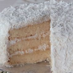 Someone has already taken a big slice of this delicious homemade coconut cake.