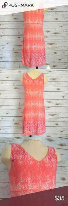"""Athleta Orange Santorini V Neck Active Dress Athleta Orange Santorini V Neck Active Dress  Size XS in excellent condition. 14.5"""" Chest 34"""" Length This has a good amount of stretch and is very comfortable. Great for tennis, golf, or every day wear Athleta Dresses Midi"""