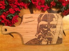 Paddle style cutting board wood burned with a star wars inspired picture of Darth Vader.