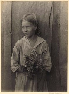 Appalachian girl holding wildflowers