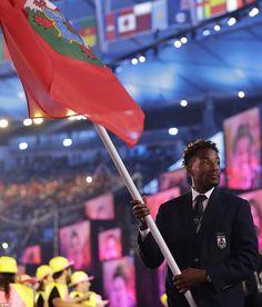 Tyrone Smith waves the flag of Bermuda during the opening ceremony at Rio Maracena Stadium...