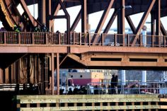 Police, fire, and other personel were at the scene on the Meridian Street bridge after a woman was killed. BOSTON GLOBE content