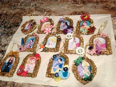 "Ornaments made from 2x3"" disney clipart (printed on photo paper), glittery gold frame ornaments from Dollar General, and various embellishments to suit each disney princess/character."