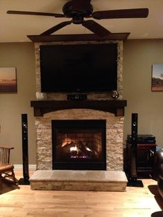 Stone Fireplace with TV | Stone on fireplace with tv mounted over mantle. I like the mantel but ...