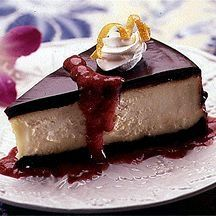 Godiva Black and White Cheesecake with Strawberry Coulis Recipe Photo