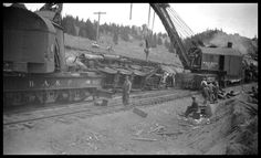 """Caption: """"Wreck of NP 2215, Class Q-4, light engine West, with Engr. Adams and work X1562, Class W, at Homestake, MT, May 1930. Two wreckers working the accident, BAP D-2 out of Butte and NP 41 out of Livingston. """"  Date: May 1930       Location: Homestake, MT       Photographer: Mrs. Nels Brandal  Railroad: Northern Pacific Railway       Station: Homestake --- USA"""