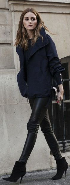 Olivia Palermo is wearing a navy blue jacket from Akris and the black leather trousers and ankle boots are from Daryl K and Aquazzura respectively