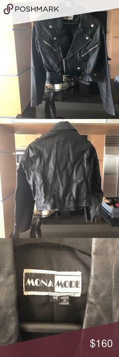 Genuine leather Moto Jacket Genuine leather moto jacket in black. Zipper detail on arms and belt with buckle in the front. Some signs of distress as show in images. Jackets & Coats