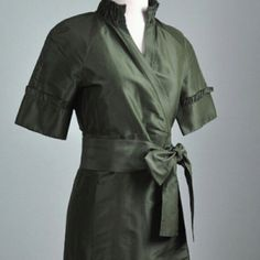 DVF wrap dress in olive silk taffeta NWOT Gorgeous and oh so very flattering! DVF wrap dress in olive 100% silk taffeta. POCKETS! Adjustable waist with wide bow sash, ruffle detail on collar coordinating with cuffs. No signs of wear, in perfect condition. Great for holiday parties and would look fabulous paired with pearls or a statement necklace. Diane von Furstenberg Dresses
