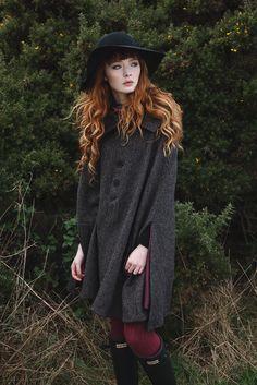 Laurie wears the Gordina cape in brown wide herringbone Harris Tweed.