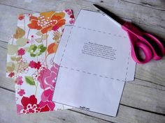 Make envelopes by recycling shopping bags.  Template from Country Living website/crafts