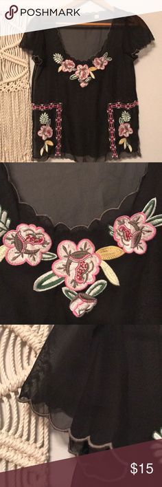 """Sheer Floral Blouse Super adorable """"Lux""""  black sheer Blouse! The intricate floral and design stitching are super sweet! The scalloped edges of the fabric are cute! Worn a dozen times but have a few similar looking shirts. Lux Tops Blouses"""