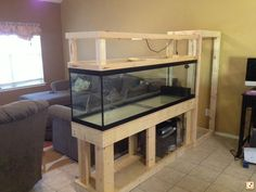 room divider aquarium - just need to frame it out with some bead board - bottom cabinet doors - light on top - maybe planters....