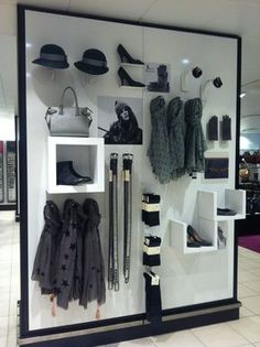 Love the use of different display equipment here, creates a really dynamic 3 dimensional design- window or in-store display featured items/live grid
